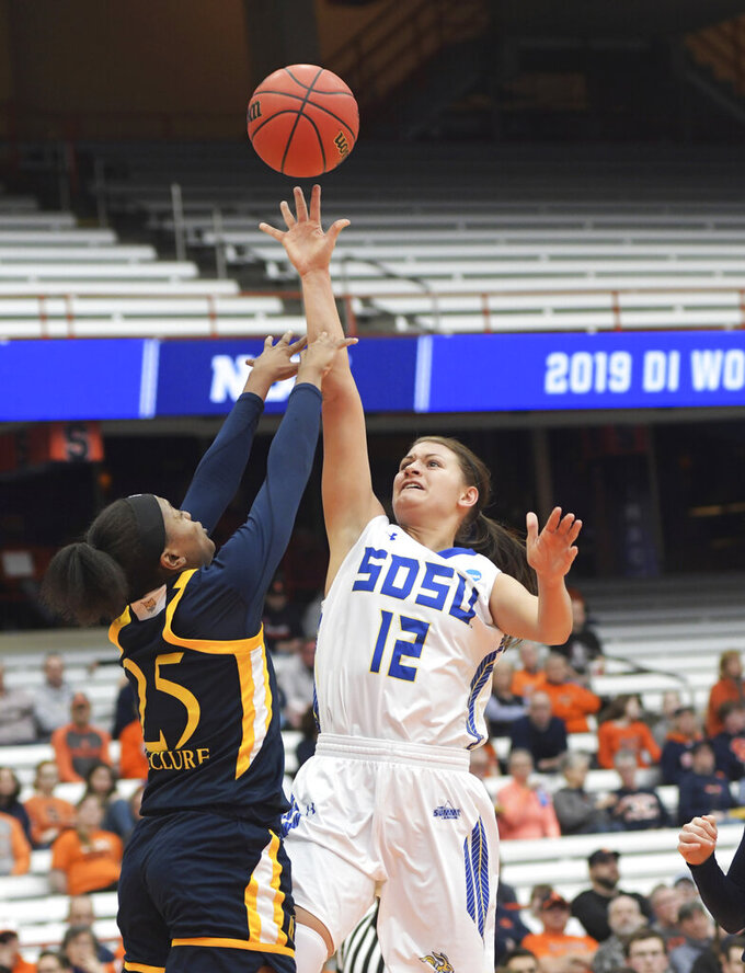 South Dakota State's Macy Miller (12) attempts a basket against Quinnipiac's Aryn McClure (25) during a first round of women's college basketball game in the NCAA Tournament in Syracuse, N.Y., Saturday, March 23, 2019. (AP Photo/Heather Ainsworth)