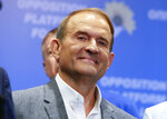 Ukrainian tycoon and one of the leaders of the 'Opposition Platform-For Life' political party Viktor Medvedchuk reacts while speaking at his headquarters after the parliamentary election in Kiev, Ukraine, Sunday, July 21, 2019. (AP Photo/Efrem Lukatsky)