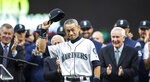 Former Seattle Mariners player Ichiro Suzuki acknowledges the crowd during a ceremony in which he was presented wit the team's Franchise Achievement Award, before a baseball game between the Chicago White Sox and the  Mariners, Saturday, Sept. 14, 2019, in Seattle. (AP Photo/Stephen Brashear)