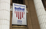 FILE - In this Feb. 29, 2012, file photo, a banner proclaiming Stockton as an All-America city hangs from city hall in Stockton, Calif. Stockton was once known as the foreclosure capital of the country and for one of the nation's largest municipal bankruptcies. The new HBO documentary