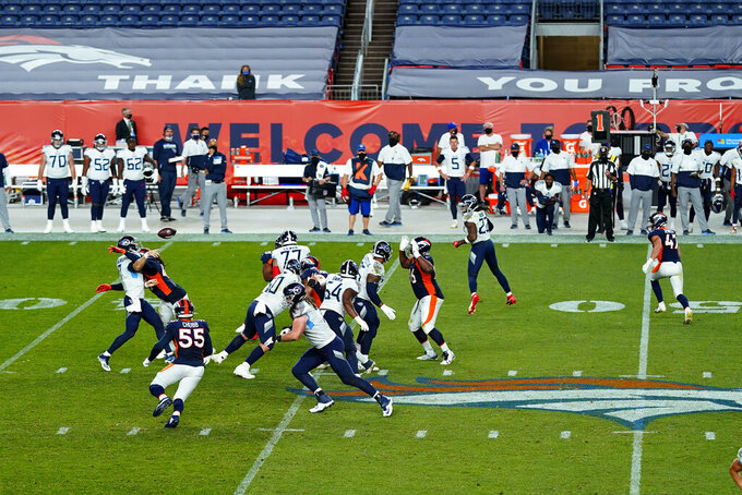 The Denver Broncos and the Tennessee Titans compete during the second half of an NFL football game, Monday, Sept. 14, 2020, in Denver. The Titans won 16-14. (AP Photo/Jack Dempsey)