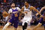 Phoenix Suns guard Tyler Johnson (16) drives past Brooklyn Nets guard Spencer Dinwiddie (8) during the first half of an NBA basketball game Sunday, Nov. 10, 2019, in Phoenix. (AP Photo/Matt York)