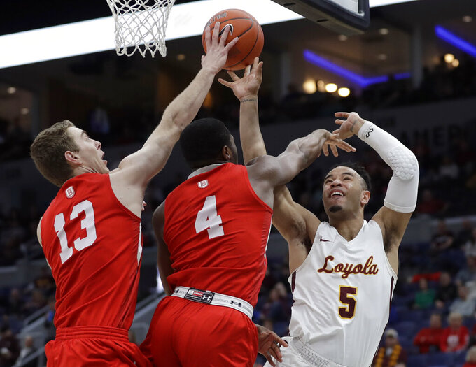 Loyola of Chicago's Marques Townes (5) has his shot knocked away by Bradley's Luuk van Bree (13) and Armon Brummett (4) during the first half of an NCAA college basketball game in the semifinal round of the Missouri Valley Conference tournament, Saturday, March 9, 2019, in St. Louis. (AP Photo/Jeff Roberson)