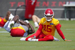Kansas City Chiefs quarterback Patrick Mahomes (15) warms up with teammates during the NFL football team's minicamp Wednesday, June 16, 2021, in Kansas City, Mo. (AP Photo/Charlie Riedel)