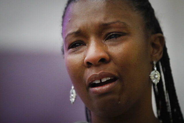 Erika Banks cries as she eulogizes her sister Lydia Nunez, who died from COVID-19, during a funeral service in memory of Nunez at the Metropolitan Baptist Church Tuesday, July 21, 2020, in Los Angeles. (AP Photo/Marcio Jose Sanchez)