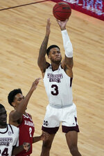 Mississippi State guard D.J. Stewart Jr. (3) shoots while Alabama forward Jordan Bruner (2) watches during the first half of an NCAA college basketball game in Starkville, Miss., Saturday, Feb. 27, 2021. (AP Photo/Rogelio V. Solis)