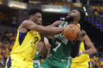 Indiana Pacers forward Thaddeus Young (21) blocks the shot of Boston Celtics guard Jaylen Brown (7) during the second half of Game 3 of an NBA basketball first-round playoff series Friday, April 19, 2019, in Indianapolis. (AP Photo/Darron Cummings)
