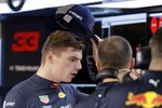 Red Bull driver Max Verstappen of the Netherlands speaks with a technician in the team's box during the second free practice at the Yas Marina racetrack in Abu Dhabi, United Arab Emirates, Friday Nov. 23, 2018. The Emirates Formula One Grand Prix will take place on Sunday. (AP Photo/Luca Bruno)