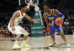 Pittsburgh guard Xavier Johnson (1) drives as Miami guard Harlond Beverly (5) defends during the first half of an NCAA college basketball game, Sunday, Jan. 12, 2020, in Coral Gables, Fla. (AP Photo/Lynne Sladky)