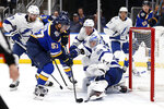 St. Louis Blues' David Perron (57) scores past Tampa Bay Lightning goaltender Andrei Vasilevskiy, of Russia, and Ondrej Palat (18) during the second period of an NHL hockey game Tuesday, Nov. 19, 2019, in St. Louis. (AP Photo/Jeff Roberson)