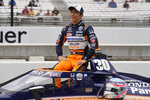 Takuma Sato, of Japan, poses for a photo during qualifications for the Indianapolis 500 auto race at Indianapolis Motor Speedway, Saturday, May 22, 2021, in Indianapolis. (AP Photo/Darron Cummings)