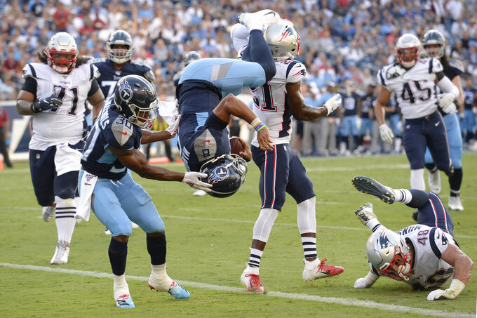 Tennessee Titans quarterback Marcus Mariota (8) flips into the end zone as he converts a 2-point conversion against the New England Patriots in the first half of a preseason NFL football game Saturday, Aug. 17, 2019, in Nashville, Tenn. (AP Photo/Mark Zaleski)