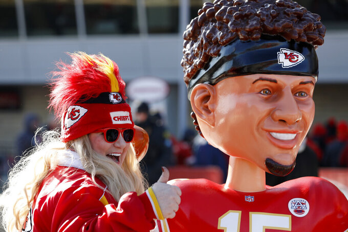A Kansas City Chiefs fan has a picture taken outside Arrowhead Stadium before the NFL AFC Championship football game against the Tennessee Titans Sunday, Jan. 19, 2020, in Kansas City, MO. (AP Photo/Charlie Neibergall)