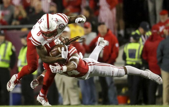 Wisconsin's D'Cota Dixon stops Nebraska's Stanley Morgan Jr. during the second half of an NCAA college football game Saturday, Oct. 6, 2018, in Madison, Wis. (AP Photo/Morry Gash)