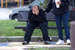 David Thevo of Kansas City, Kansas, is consoled Sunday, Oct. 6, 2019 by a friend at nearby Lally Park after two gunmen entered a Kansas City, Kansas, bar early Sunday and shot multiple people, killing several of them.  (Tammy Ljungblad/The Kansas City Star via AP)