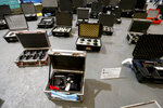 Stolen film equipment is displayed for a media presentation at the police department in Buenos Aires, Argentina, Friday, Sept. 14, 2018. Argentine authorities say they have seized about $3 million in cameras, lenses and other film equipment stolen in Hollywood and New York. (AP Photo/Natacha Pisarenko)