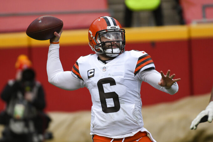 Cleveland Browns quarterback Baker Mayfield throws a pass during the first half of an NFL divisional round football game against the Kansas City Chiefs, Sunday, Jan. 17, 2021, in Kansas City. (AP Photo/Reed Hoffmann)