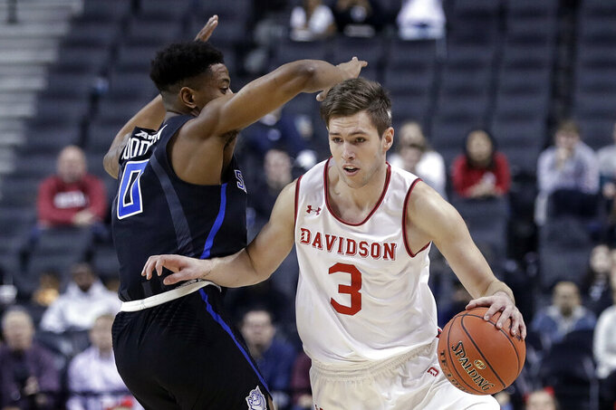 Davidson's Jon Axel Gudmundsson (3) drives past Saint Louis's Jordan Goodwin (0) during the first half of an NCAA college basketball game in the semifinal round of the Atlantic 10 men's tournament Saturday, March 16, 2019, in New York. St. Bonaventure won 68-51. (AP Photo/Frank Franklin II)