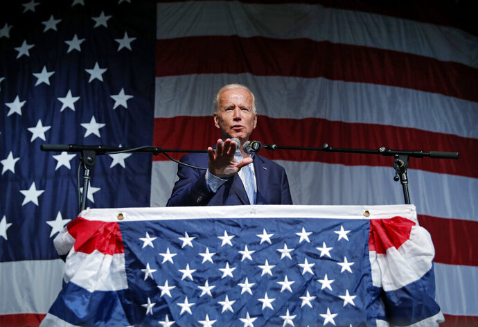 In this Aug. 9, 2019 photo, former Vice President and Democratic presidential candidate Joe Biden speaks at the Iowa Democratic Wing Ding at the Surf Ballroom, in Clear Lake, Iowa. As the U.S. economy flashes recession warning signs, Democratic presidential candidates are leveling pre-emptive blame on President Donald Trump. They argue that his aggressive and unpredictable tariff policies are to blame for gloomy economic forecasts.  (AP Photo/John Locher)