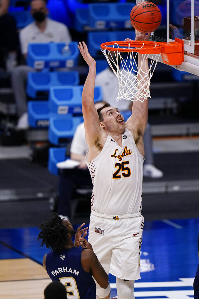 Loyola Chicago center Cameron Krutwig (25) shoots over Georgia Tech guard Bubba Parham (3) in the first half of a college basketball game in the first round of the NCAA tournament at Hinkle Fieldhouse, Indianapolis, Friday, March 19, 2021. (AP Photo/AJ Mast)
