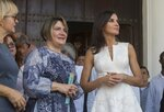 Spain's Queen Letizia, right, and Lis Cuesta Peraza, wife of Cuba's President Miguel Diaz-Canel, walk in Old Havana, Cuba, Tuesday, Nov. 12, 2019. (AP Photo/Ismael Francisco, Pool)