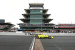 FILE - In this May 26, 2019, file photo, Simon Pagenaud, of France, crosses the start/finish line on the start of the Indianapolis 500 IndyCar auto race at Indianapolis Motor Speedway, in Indianapolis. Indianapolis Motor Speedway and the IndyCar Series have been sold to Penske Entertainment Corp. in a stunning announcement that relinquishes control of the iconic speedway from the Hulman family after 74 years. (AP Photo/Rob Baker, File)