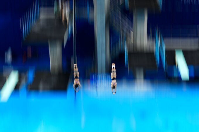 Mun Yen Leong and Pandelela of Malaysia compete during the women's synchronised 10-meter platform final at the 2020 Summer Olympics, Monday, July 26, 2021, in Tokyo, Japan. (AP Photo/Morry Gash)
