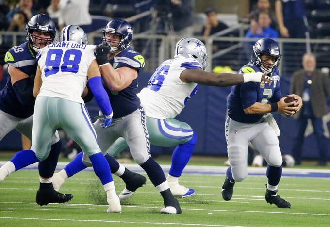 Dallas Cowboys defensive tackle Maliek Collins (96) sacks Seattle Seahawks quarterback Russell Wilson (3) in the first half of the NFC wild-card NFL football game in Arlington, Texas, Saturday, Jan. 5, 2019. (AP Photo/Michael Ainsworth)