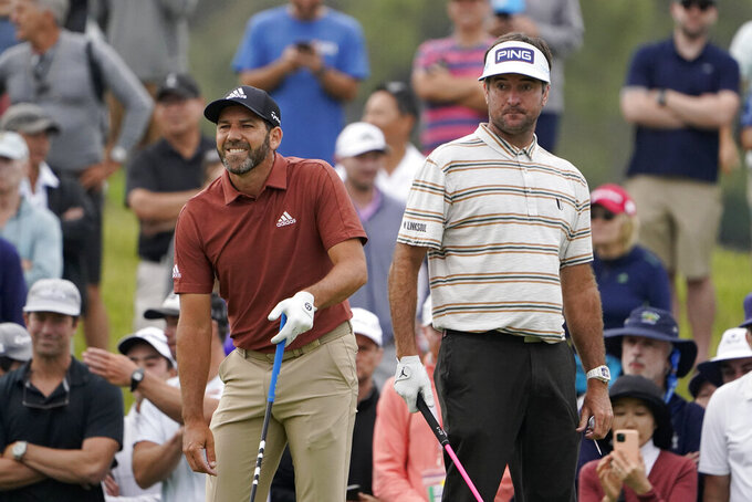 Sergio Garcia, of Spain, left, watches his shot on the 15th tee as Bubba Watson looks on during the second round of the U.S. Open Golf Championship, Friday, June 18, 2021, at Torrey Pines Golf Course in San Diego. (AP Photo/Jae C. Hong)