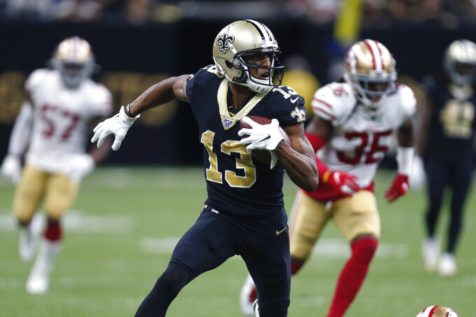 New Orleans Saints wide receiver Michael Thomas (13) carries for a touchdown in the second half an NFL football game against the San Francisco 49ers in New Orleans, Sunday, Dec. 8, 2019. (AP Photo/Butch Dill)