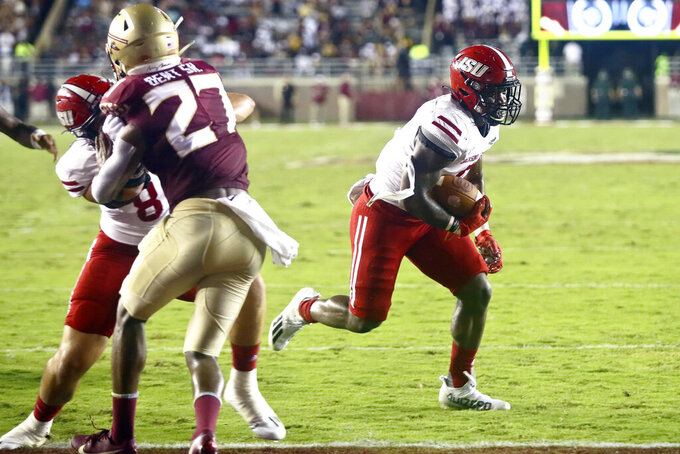 Jacksonville State running back Josh Samuel, right, runs past a block for a touchdown in the second quarter of an NCAA college football game against Florida State Saturday, Sept. 11, 2021, in Tallahassee, Fla. (AP Photo/Phil Sears)