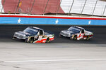 Christian Eckes (18) and Kyle Busch (51) come out of Turn 4 during the NASCAR trucks race at Texas Motor Speedway in Fort Worth, Texas, Saturday, July 18, 2020. (AP Photo/Ray Carlin)