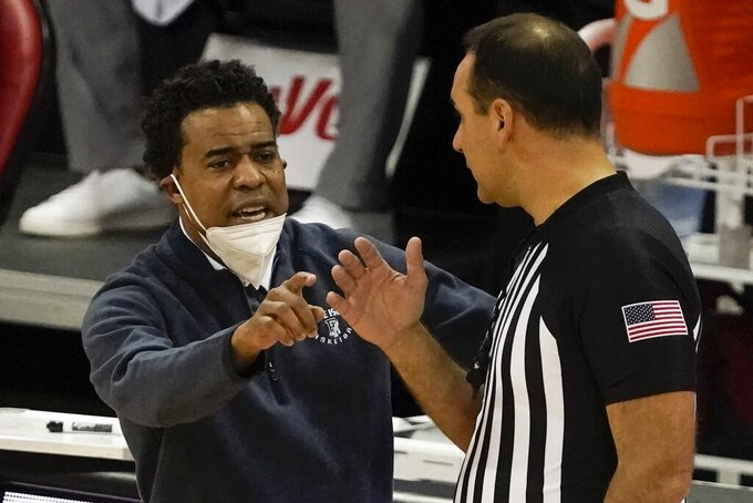 Rhode Island head coach David Cox argues a call during the second half of an NCAA college basketball game against Wisconsin Wednesday, Dec. 9, 2020, in Madison, Wis. (AP Photo/Morry Gash)