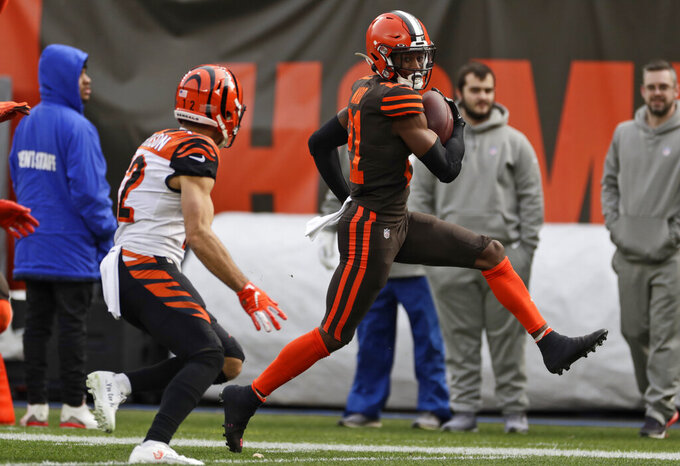 Cleveland Browns cornerback Denzel Ward scores on a 61-yard interception return during the first half of an NFL football game against the Cincinnati Bengals, Sunday, Dec. 8, 2019, in Cleveland. (AP Photo/Ron Schwane)