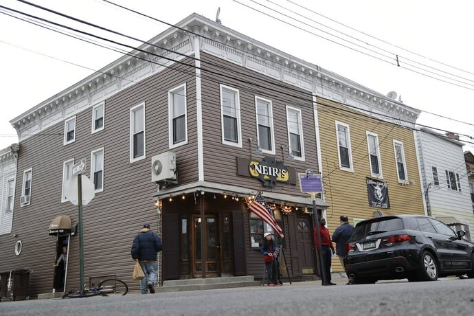 Patrons gather outside of Neir's Tavern on Saturday, Jan. 11, 2020, in the Queens borough of New York. The 190-year-old New York City tavern where scenes from the movie