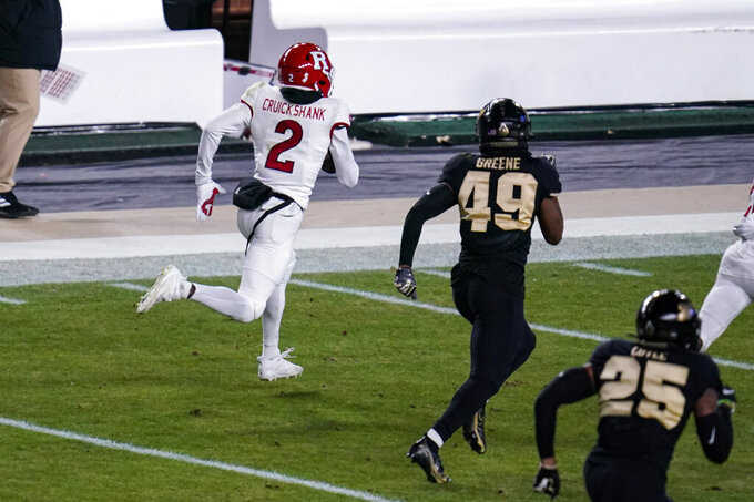 Rutgers' Aron Cruickshank (2) gets past Purdue's Zane Greene (49) on his way to a touchdown on a 100-yard kickoff return during the third quarter of an NCAA college football game in West Lafayette, Ind., Saturday, Nov. 28, 2020. (AP Photo/Michael Conroy)