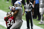 Detroit Lions wide receiver Kenny Golladay (19) makes the catch against Atlanta Falcons cornerback A.J. Terrell (24) during the second half of an NFL football game, Sunday, Oct. 25, 2020, in Atlanta. (AP Photo/John Bazemore)