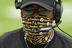 Pittsburgh Steelers head coach Mike Tomlin walks the sideline during the first half of an NFL football game, Sunday, Oct. 11, 2020, in Pittsburgh. (AP Photo/Keith Srakocic)
