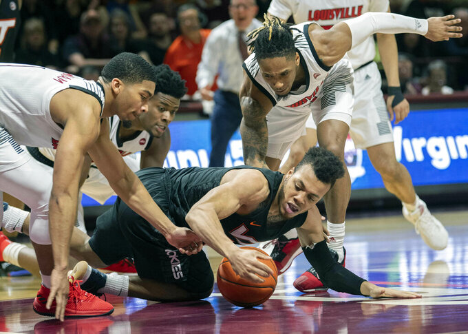 Left to right, Louisville guard Christen Cunningham, Louisville center Steven Enoch, Virginia Tech Hokies guard Wabissa Bede and Louisville guard Khwan Fore, battle for a loose ball during the second half of an NCAA college basketball game Monday, Feb. 4, 2019, in Blacksburg, Va. Louisville won 72-64. (AP Photo/Don Petersen)