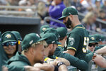 Oakland Athletics' Mike Fiers is greeted by teammates during the second inning of a spring training baseball game against the San Francisco Giants, Sunday, Feb. 23, 2020, in Mesa, Ariz. (AP Photo/Darron Cummings)