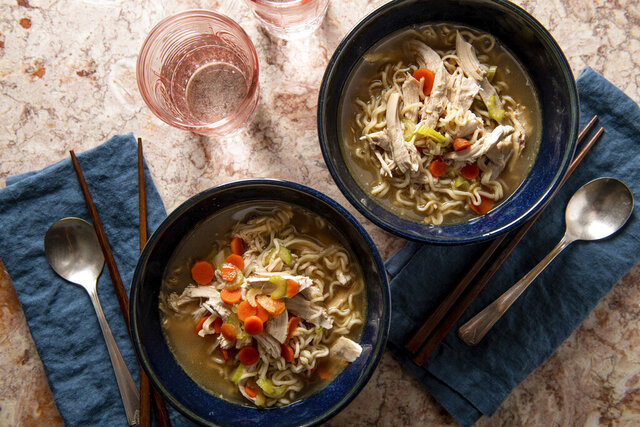 This image shows a recipe for chicken ramen noodle soup. More people are cooking at home these days, and when they do eat restaurant food, they're often looking for comfort food, experts say. Other trends include simpler recipes, recipes with fewer ingredients, one-pot meals, sheet-pan meals, finger food and pantry-ingredient recipes, all up significantly year over year. (Cheyenne M. Cohen/Katie Workman via AP)