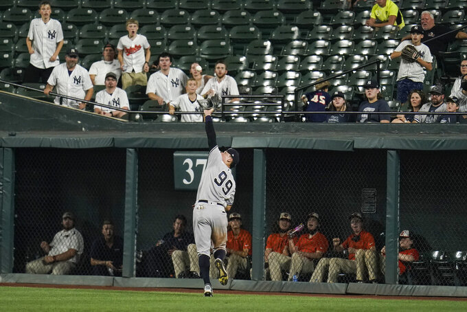 New York Yankees right fielder Aaron Judge (99) reaches to make a catch on a line drive hit by Baltimore Orioles' Anthony Santander during the eighth inning of a baseball game, Tuesday, Sept. 14, 2021, in Baltimore. (AP Photo/Julio Cortez)