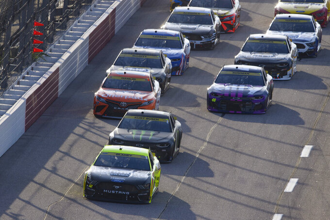 Ryan Blaney (12) leads as Kurt Busch pulls behind him at the start of a NASCAR Cup Series auto race Sunday, Sept. 5, 2021, in Darlington, S.C. (AP Photo/John Amis)