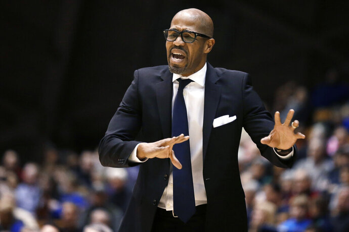 FILE - In this Jan. 10, 2015, file photo, Penn head coach Jerome Allen shouts instructions to his players during the second half of an NCAA college basketball game against Princeton in Princeton, N.J. The former Penn coach, now an assistant coach in the NBA with the Boston Celtics, has been sentenced to probation and ordered to pay a fine for accepting $300,000 in bribes to get a wealthy Florida businessman's son into the University of Pennsylvania. In addition to four years' probation, the 47-year-old Allen must pay a $202,000 fine and forfeit another $18,000. (AP Photo/Mel Evans, File)