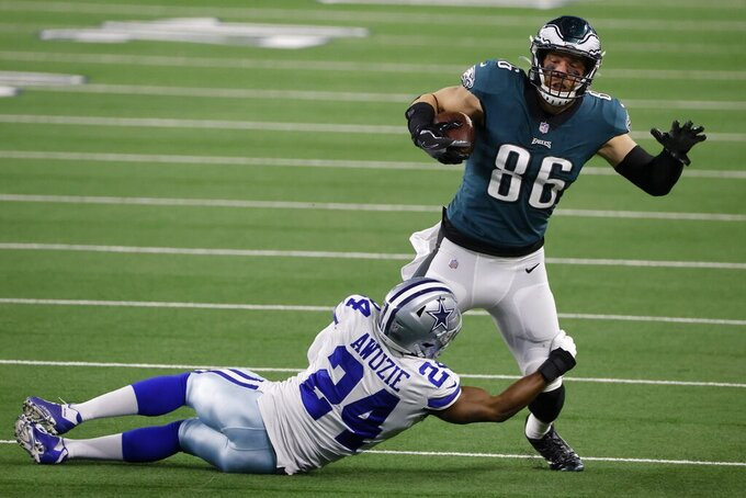 Philadelphia Eagles tight end Zach Ertz (86) is stopped after catching a pass by Dallas Cowboys cornerback Chidobe Awuzie (24) in the second half of an NFL football game in Arlington, Texas, Sunday, Dec. 27. 2020. (AP Photo/Michael Ainsworth)