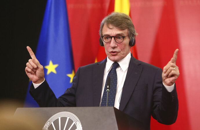 European Parliament President David Sassoli gestures while talking to the media on a joint news conference with North Macedonia's Prime Minister Zoran Zaev, following their meeting in the government building in Skopje, North Macedonia, Monday, Nov. 4, 2019. The President of European Parliament David Sassoli has offered comfort to North Macedonia after recent failure this country to start membership talks with European Union. (AP Photo/Boris Grdanoski)