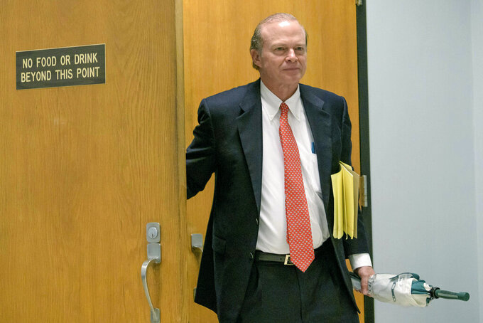 """Edward Dirk Wegmann, attorney for the New Orleans Archdiocese, leaves a hearing at Orleans Parish Civil District Court in New Orleans, Thursday, Feb. 20, 2020. The New Orleans Saints headed to court Thursday in a bid to block the release of hundreds of confidential emails detailing the behind-the-scenes public relations work the team did for the area's Roman Catholic archdiocese amid its sexual abuse crisis. The request comes amid claims that the NFL team joined the Archdiocese of New Orleans in a """"pattern and practice"""" of concealing sexual abuse — an allegation the Saints have vehemently denied.   (AP Photo/Matthew Hinton)"""