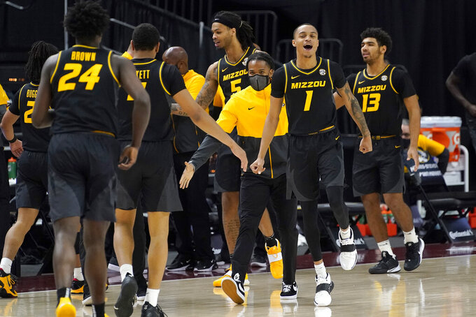 Missouri guard Xavier Pinson (1) reacts as his teammates come off the court during a time out against Texas A&M in the second half of an NCAA college basketball game Saturday, Jan. 16, 2021, in College Station, Texas. (AP Photo/Sam Craft)