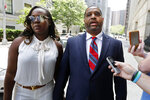Former University of Arizona assistant men's basketball coach Emanuel Richardson leaves Manhattan federal court in New York, after he was sentenced on a bribery conspiracy charge in the college basketball recruiting scandal that hit major schools, Thursday, June 6, 2019. (AP Photo/Richard Drew)