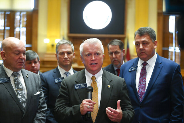 New state Sen. Randy Robertson, R-Cataula, center, is flanked by Majority Leader Mike Dugan, R-Carrollton, left, and Majority Whip Steve Gooch, R-Dahlonega, right, as he speaks to the media during the opening day of the year for the general session of the state legislature, Monday, Jan. 13, 2020, in Atlanta. (AP Photo/John Amis)